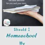 Teen holding homeschool notebook.