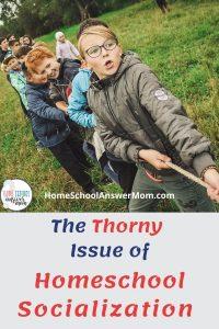 homeschool kids socializing while playing tug of war